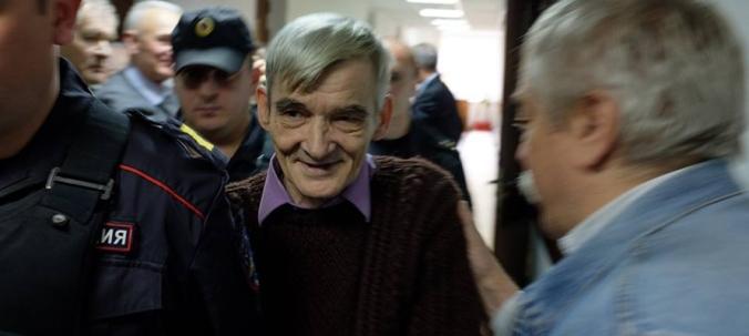 Dmitriev greeted by Razumov in court corridor